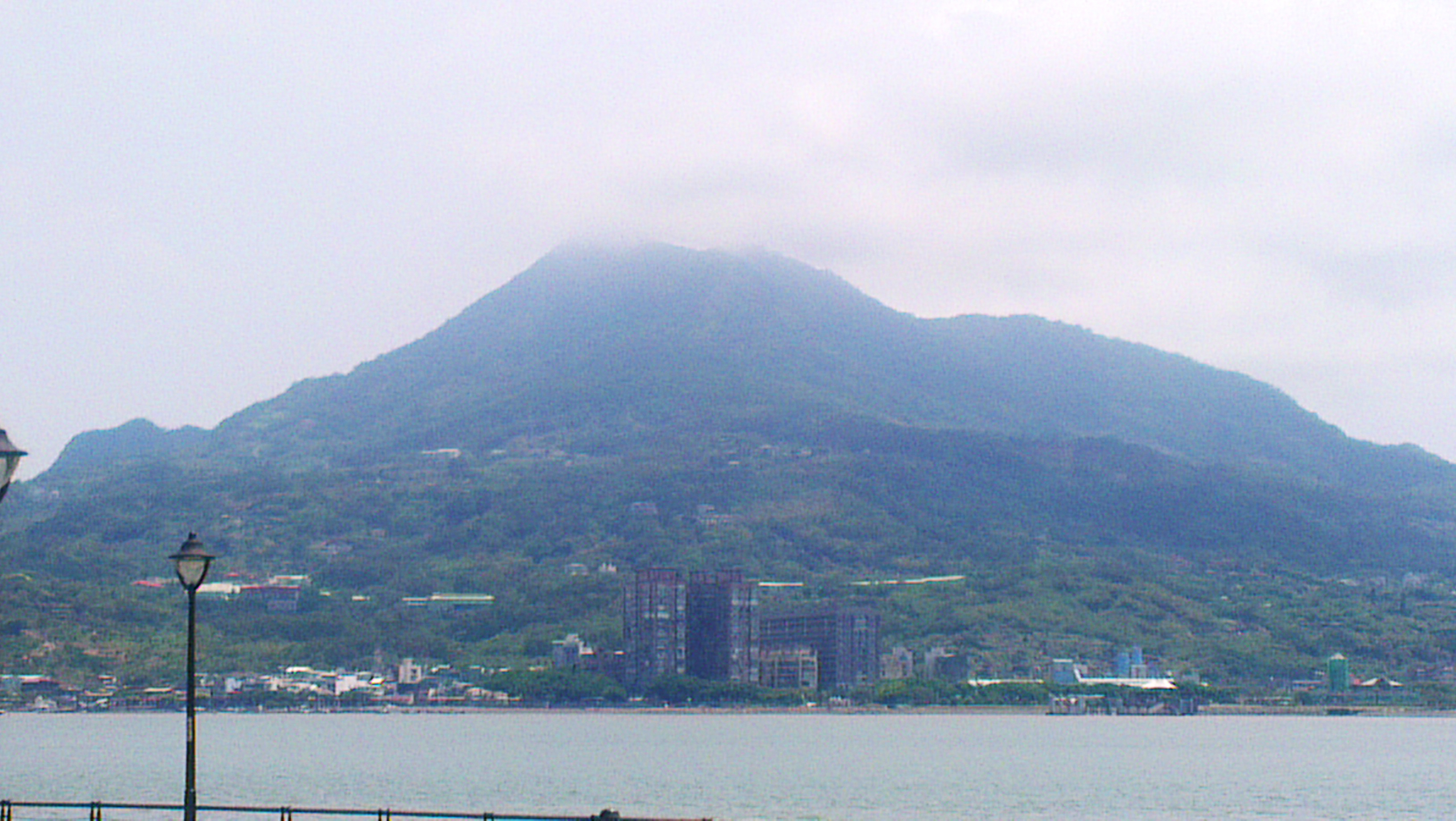 A view of Kuanyin Mountain from the Tamsui River